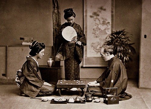 master and geisha playing go