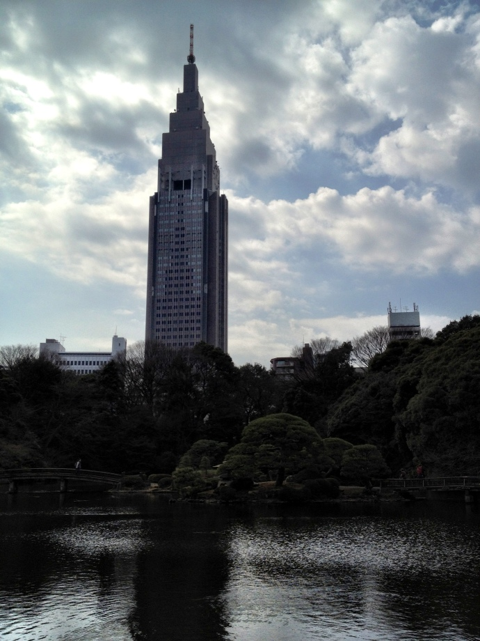 Shinjuku gyoen with the sky scrapers towering above the treeline.