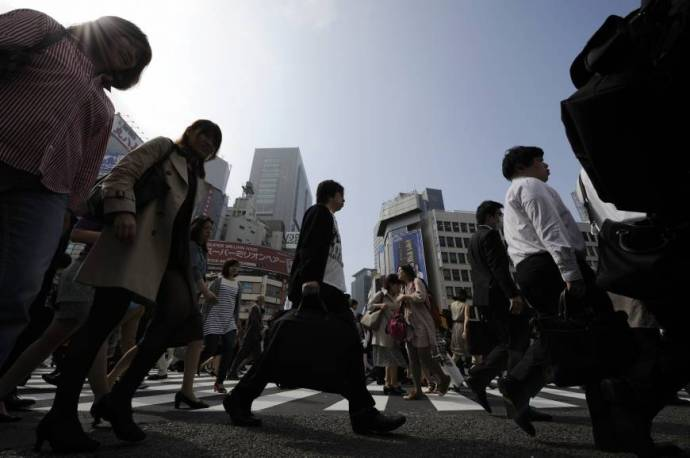The Cabinet Office said Thursday Japan's economy enjoyed a stronger than expected recovery last quarter, growing at a 3.5 percent annual pace as the government stepped up public works spending and eased credit to encourage investment.