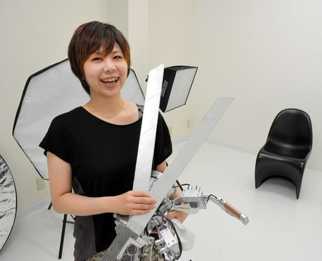 Marika Oyama shows her self-made props for cosplay photo shoots at her Studio Angle in the Marunouchi area of Okayama's Kita Ward.